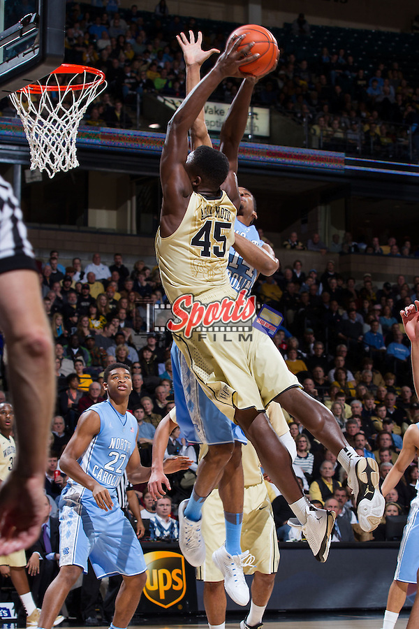 Arnaud William Adala Moto (45) of the Wake Forest Demon Deacons attacks the basket during first half action against the North Carolina Tar Heels at the LJVM Coliseum on January 5, 2014 in Winston-Salem, North Carolina.  The Demon Deacons defeated the Tar Heels 73-67.   (Brian Westerholt/Sports On Film)