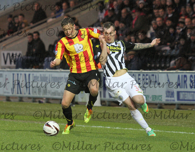 James Craigen (left) and Gregg Wylde challenge for the ball in the St Mirren v Partick Thistle Scottish Professional Football League Premiership match played at St Mirren Park, Paisley on 25.1.14.