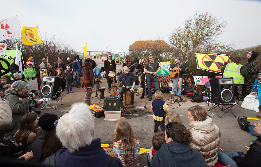 Theo Simon of Sieze the Day  sings protest  songs at the gates of Hinkely c  power station, Somerset ; during   a march against the building of new nuclear in the UK , 10 th March 2012..Around 1000 people turned up at the demo.