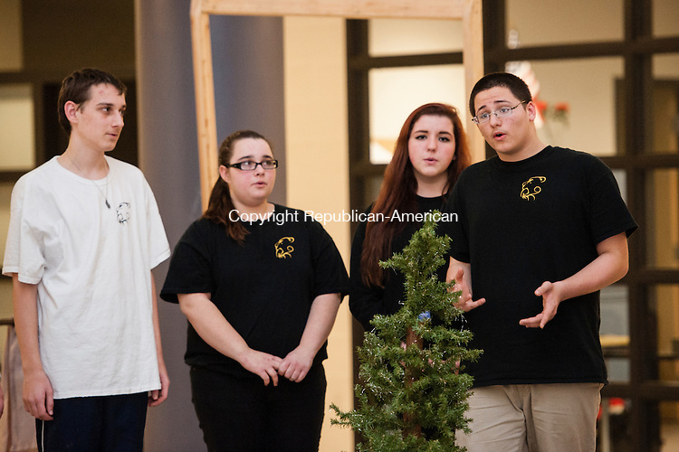 """WATERBURY, CT-1 December 2014-120114EC04-  Students Jacob Bethin, Bekka Bethin, Eve DiAnglis and Tyler Rivera -- who plays Charlie Brown -- rehearse Monday night at Kaynor Tech in  Waterbury. The school will be putting on """"A Charlie Brown Christmas"""" play, along with a talent show this weekend. The performances are in conjunction with Kaynor Tech's holiday bazaar and craft show. The talent show begins at 7pm Friday, with another performance Saturday at noon, followed by the Charlie Brown play. Erin Covey Republican-American"""