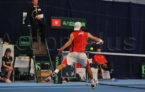 08.07.2011 Davis Cup Tennis from Dublin. Ireland v Tunisia. Malek Jaziri of Tunisia closes in on the net