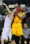 RAPID CITY, S.D. -- DECEMBER 7, 2013 -- Wyoming's Derek Cooke Jr. tangles with South Dakota's Eric Robertson #41 during a rebound during their game Saturday at the Rapid City Civic Center Ice Arena.  (Photo by Dick Carlson/Inertia)
