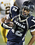 Nevada's Richy Turner (12) scores the game-tying touchdown against Wyoming during the second half of an NCAA college football game in Reno, Nev., on Saturday, Oct. 6, 2012. Nevada won 35-28 in overtime.(AP Photo/Cathleen Allison)