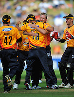 Wellington's Damien Martin congratulates Luke Woodcock catching Peter Fulton. HRV Cup Twenty20 cricket - Wellington Firebirds v Canterbury Wizards at Allied Nationwide Finance Basin Reserve, Wellington. Sunday, 5 December 2010. Photo: Dave Lintott / lintottphoto.co.nz