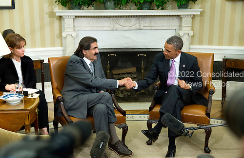 United States President Barack Obama shakes hands with the Amir of Qatar, Hamad bin Khalifa al-Thani, in the Oval Office of the White House on Tuesday, April 23, 2013.<br /> Credit: Joshua Roberts / Pool via CNP