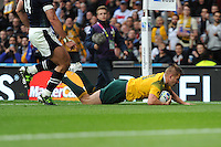 Drew Mitchell of Australia dives over to score a try during the Quarter Final of the Rugby World Cup 2015 between Australia and Scotland - 18/10/2015 - Twickenham Stadium, London<br /> Mandatory Credit: Rob Munro/Stewart Communications