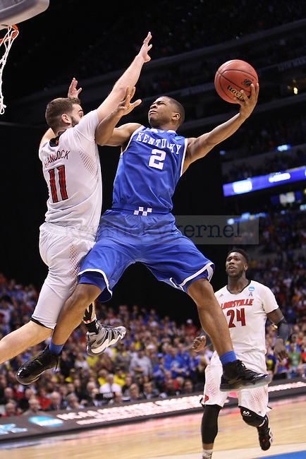 UK guard Aaron Harrison (2) goes to shoot the ball during the NCAA Sweet 16 vs. UofL at the Lucas Oil Stadium in Indianapolis , Ind., on Friday, March 28, 2014. Photo by Emily Wuetcher | Staff