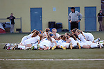 Warrior Run  High School girls soccer team huddle in mid-field before a game.