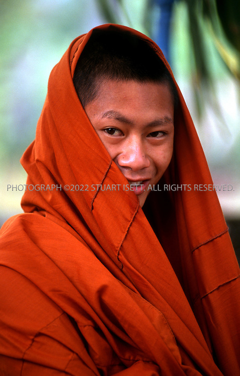 5/1/2003--Luang Prabang, Laos..A young Buddhist monk at Wat Xieng Thong on the northern tip of Luang Prabang. It was built by King Saisetthathirat in 1560 and is located on a peninsula, in between the Mekong and Khan rivers...All photographs ©2003 Stuart Isett.All rights reserved.This image may not be reproduced without expressed written permission from Stuart Isett.