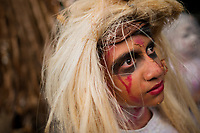 A Salvadoran boy with face paint performs an indigenous mythology character called La Llorona in the La Calabiuza parade at the Day of the Dead festivity in Tonacatepeque, El Salvador, 1 November 2016. The festival, known as La Calabiuza since the 90s of the last century, joins Salvador's pre-Hispanic heritage and the mythological figures (La Sihuanaba, El Cipitío, La Llorona etc.) collected from the whole Central American region, together with the catholic All Saints Day holiday and its tradition of honoring the dead relatives. Children and youths only, dressed up in scary costumes and carrying painted carts, march from the local cemetery to the downtown plaza where the party culminates with music, dance, drinking and eating pumpkin (Ayote) with honey.
