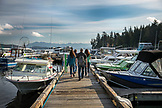 USA, Alaska, Ketchikan, a family heads down the dock towards the boat in preparation to go fish the Behm Canal near Clarence Straight, Knudsen Cove along the Tongass Narrows