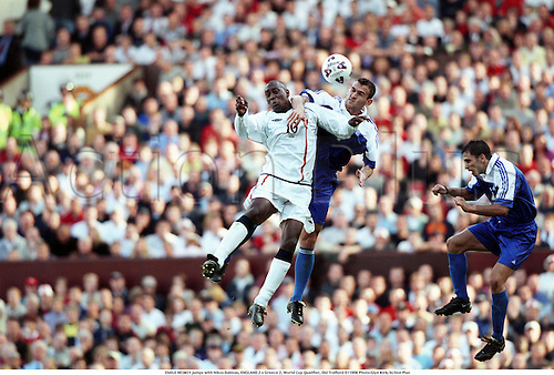 EMILE HESKEY jumps with Nikos Dabizas, ENGLAND 2 v Greece 2, World Cup Qualifier, Old Trafford 011006. Photo:Glyn Kirk/Action Plus...2001.Soccer.Headers.football.international.internationals.association