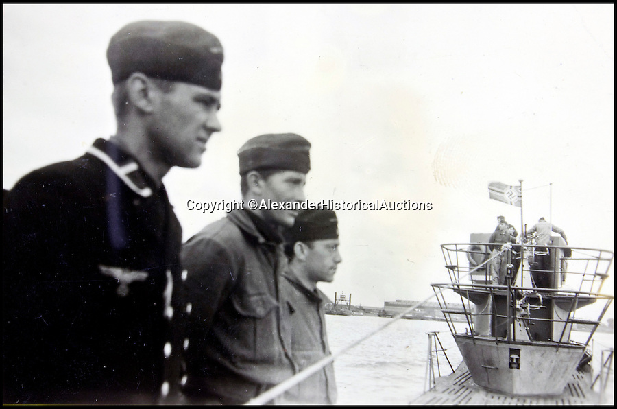 BNPS.co.uk (01202 558833)<br /> Pic: AlexanderHistoricalAuctions/BNPS<br /> <br /> Crewmen on the deck of the submarine.<br /> <br /> Fascinating images which provide a snapshot of life on a German U-Boat have been unearthed.<br /> <br /> Interestingly, the photographs give us an insight into joyous occasions on the U-976 destroyer including alcohol fuelled parties and gatherings in the mess hall.<br /> <br /> The photo album which was collated by First Officer Lieutenant Wilhelm Hinrichs has now emerged for auction and is tipped to sell for £1,200.<br /> <br /> The U-976 was sunk on March 25, 1944, just a few months before the Normandy landings, near St Nazaire in France by gunfire from two British Mosquito fighter-bombers.