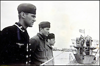 BNPS.co.uk (01202 558833)<br /> Pic: AlexanderHistoricalAuctions/BNPS<br /> <br /> Crewmen on the deck of the submarine.<br /> <br /> Fascinating images which provide a snapshot of life on a German U-Boat have been unearthed.<br /> <br /> Interestingly, the photographs give us an insight into joyous occasions on the U-976 destroyer including alcohol fuelled parties and gatherings in the mess hall.<br /> <br /> The photo album which was collated by First Officer Lieutenant Wilhelm Hinrichs has now emerged for auction and is tipped to sell for &pound;1,200.<br /> <br /> The U-976 was sunk on March 25, 1944, just a few months before the Normandy landings, near St Nazaire in France by gunfire from two British Mosquito fighter-bombers.