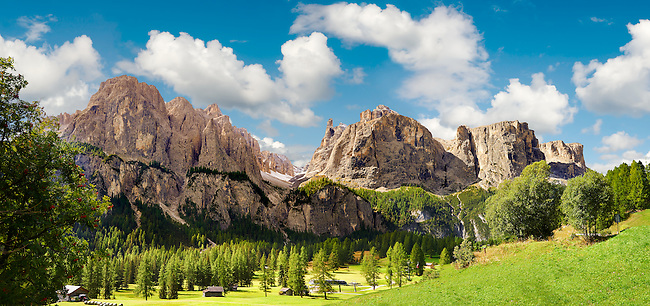 Mountains and pastures of the Sella plateau near Colfosco, 1,645 m (5,396 ft),  at the foot of the Sella group (Grup dl Sela) and Mount Sassongher, the Dolomite mountains, Alta Badia, Italy