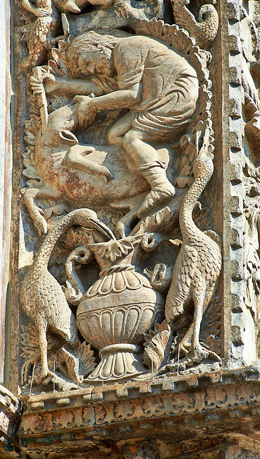 13th century Medieval Romanesque Sculptures from the introdos of the second arch of the facade of St Mark's Basilica, Venice, depicting December from the Months of the Zodiac .