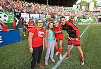 Portland, Oregon - Sunday September 4, 2016: Portland Thorns FC midfielder Allie Long (10) and Portland Thorns FC forward Christine Sinclair (12) poses with the Girls Inc Girls of the Game during a regular season National Women's Soccer League (NWSL) match at Providence Park.