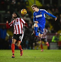 Lincoln City's Matt Green vies for possession with Notts County's Elliott Hewitt<br /> <br /> Photographer Chris Vaughan/CameraSport<br /> <br /> The EFL Sky Bet League Two - Lincoln City v Notts County - Saturday 13th January 2018 - Sincil Bank - Lincoln<br /> <br /> World Copyright &copy; 2018 CameraSport. All rights reserved. 43 Linden Ave. Countesthorpe. Leicester. England. LE8 5PG - Tel: +44 (0) 116 277 4147 - admin@camerasport.com - www.camerasport.com