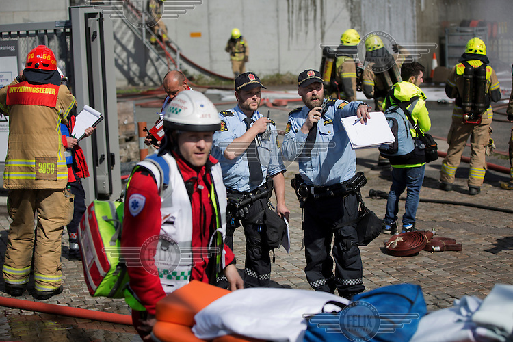 Emergency personell responds to a &quot;fire&quot; . HarbourEx15, a field training exercise with scenarios connected to operations in the harbor April 27th &ndash; 29th 2015.<br /> <br /> The scenario of the exercise is a major accident on Sydhavna /Sjursj&oslash;ya area of Oslo, and will involve rescue and emergency response agencies from tactical to strategic level. (photo: Fredrik Naumann/Felix Features)