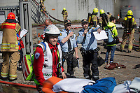Emergency personell responds to a &quot;fire&quot; . HarbourEx15, a field training exercise with scenarios connected to operations in the harbor April 27th &ndash; 29th 2015.<br />