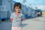 A girl in a camp for internally displaced families in Ankawa, near Erbil, Iraq, on April 8, 2016. Residents of the camp, mostly Christians, were displaced from Mosul, Qaraqosh and other communities in Iraq when ISIS swept through the area in 2014.