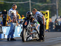 Jun 3, 2016; Epping , NH, USA; NHRA top fuel Harley motorcycle rider Len Darnell with crew members during qualifying for the New England Nationals at New England Dragway. Mandatory Credit: Mark J. Rebilas-USA TODAY Sports