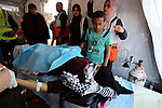 A wounded Palestinian woman is treated during clashes with Israeli troops following the tents protest where Palestinians demand the right to return to their homeland at the Israel-Gaza border, in Khan Younis in the southern Gaza Strip, March 08, 2019. A Palestinian youth was killed by Israeli fire as he protested on the frontier of the Gaza Strip and Israel on Friday, and at least 41 other were wounded according to Gaza's health ministry. Photo by Ashraf Amra