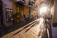 Taormina, tourists entering Corso Umberto, the main street in Taormina at sunset, Sicily, Italy, Europe. This ia a photo of tourists entering Corso Umberto, the main street in Taormina at sunset, Sicily, Italy, Europe.