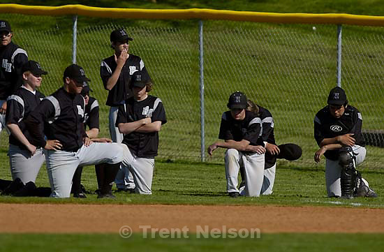 Highland baseball players after losing in the final inning. East vs. Highland high school baseball. East wins 4-3.<br />