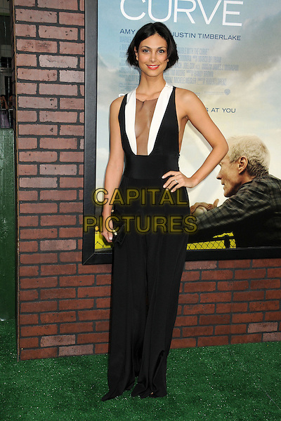"Morena Baccarin.""Trouble With The Curve"" Los Angeles Premiere held at the Regency Village Theatre, Westwood, California, USA..September 19th, 2012.full length white hand on hip dress sleeveless plunging neckline cleavage clutch bag sheer black.CAP/ADM/BP.©Byron Purvis/AdMedia/Capital Pictures."