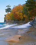 Pictured Rocks National Lakeshore, MI<br /> Chapel River flowing into Lake Superior under fall colored forest at Chapel Rock