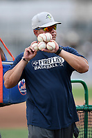 Manager Pedro Lopez (16) of the Columbia Fireflies throws batting practice before a game against the Charleston RiverDogs on Wednesday, August 29, 2018, at Spirit Communications Park in Columbia, South Carolina. Charleston won, 6-1. (Tom Priddy/Four Seam Images)