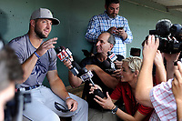 Left fielder Tim Tebow (15) of the Columbia Fireflies speaks with members of the media before a game against the Greenville Drive on Tuesday, June 13, 2017, at Fluor Field at the West End in Greenville, South Carolina. Greenville won, 5-4. (Tom Priddy/Four Seam Images)