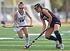 Grace Tauckus #17 of Cold Spring Harbor, right, gets pressured by Caitlin Cook #18 of Garden City during the Nassau County varsity field hockey Class B final at Berner Middle School in Massapequa on Sunday, Oct. 28, 2018. Garden City won by a score of 5-1.