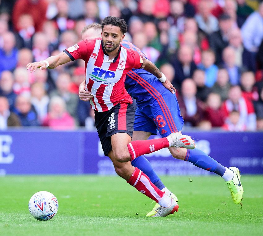 Lincoln City's Bruno Andrade is fouled by Sunderland's Laurens De Bock for a penalty<br /> <br /> Photographer Andrew Vaughan/CameraSport<br /> <br /> The EFL Sky Bet League One - Lincoln City v Sunderland - Saturday 5th October 2019 - Sincil Bank - Lincoln<br /> <br /> World Copyright © 2019 CameraSport. All rights reserved. 43 Linden Ave. Countesthorpe. Leicester. England. LE8 5PG - Tel: +44 (0) 116 277 4147 - admin@camerasport.com - www.camerasport.com