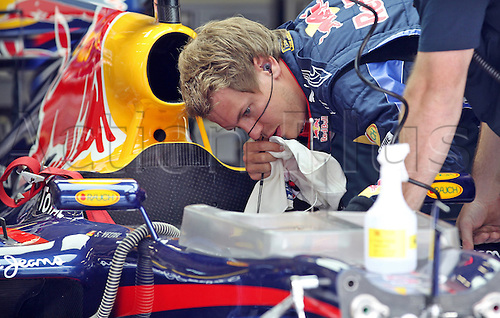 German Formula One driver Sebastian Vettel of Red Bull checks his race car prior to the third practice session for the Formula One Grand Prix at Istanbul Park circuit in Istanbul, Turkey, 29 May 2010. The Grand Prix of Turkey will be held on 30 May 2010.