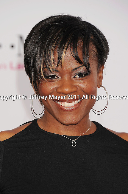 LOS ANGELES, CA - FEBRUARY 20: Sheryl Swoopes arrives at the T-Mobile Magenta Carpet at the 2011 NBA All-Star Game at L.A. Live on February 20, 2011 in Los Angeles, California.