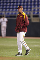 Minnesota Golden Gophers pitching coach Todd Oakes walks to the mound during a game against the Texas Longhorns at the Metrodome on March 22, 2013 in Minneapolis, Minnesota. (Brace Hemmelgarn/Four Seam Images)