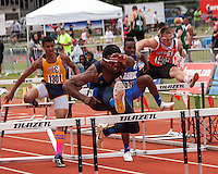 John Burroughs junior Ezekiel Elliott sprints to victory in the 110-meter hurdles in Class 3 at the 2013 Missouri High School State Track and Field Championships in Jefferson City, MO. The title was the first of four on the day for the three-sport star who is headed to Ohio State to play football.
