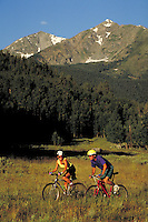 Steve Holmes (MR496) & Holly Issacson (MR431) mountain biking, Peak One, Summit County, CO. Steve Holmes (MR496) & Holly Issacson (MR431). Summit County, Colorado.