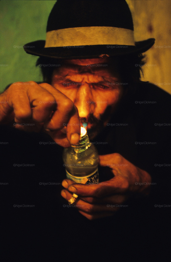 Sixty five year old Tito, smoking crack. He lost his family because of his drug addiction and survives day by day. Pescadera barrio. Almeria, Spain 2001.