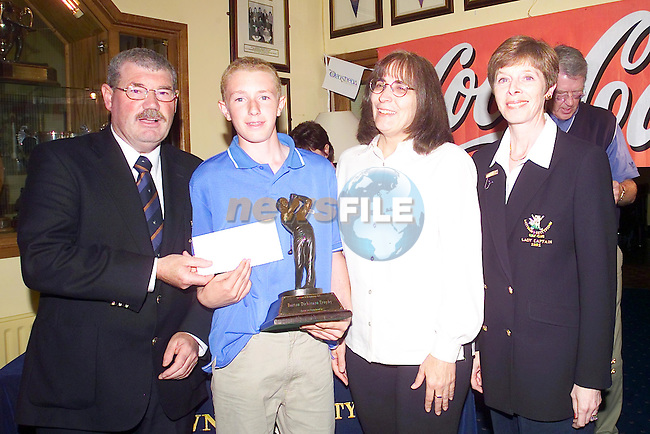 The Coca Cola Juvenile Championship..Kevin Harmon Balbriggan golf club winner of the Becton Dickenson Trophy Pictured with Captain Tom Ryan, Beckie Long from Drogheda concentrates and L-Captain Helen delany..Picture Fran Caffrey Newsfile...This Picture is sent to you by:..Newsfile Ltd.The View, Millmount Abbey, Drogheda, Co Louth, Ireland..Tel: +353419871240.Fax: +353419871260.GSM: +353862500958.ISDN: +353419871010.email: pictures@newsfile.ie.www.newsfile.ie