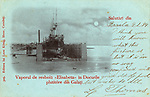 A view of the battleship Elisabeta in a floating dock at Galati, Romania - the largest seaport on the River Danube. The handwritten message states that the cards recipient will recognise the dock set-up, although it is no way near as impressive as what one would find in Liverpool!     Date: 1899