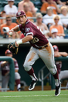 Texas A&M Aggies third baseman Adam Smith #20 prepares to throw to first after a Texas Longhorns bunt in NCAA Big XII Conference baseball on May 21, 2011 at Disch Falk Field in Austin, Texas. (Photo by Andrew Woolley / Four Seam Images)