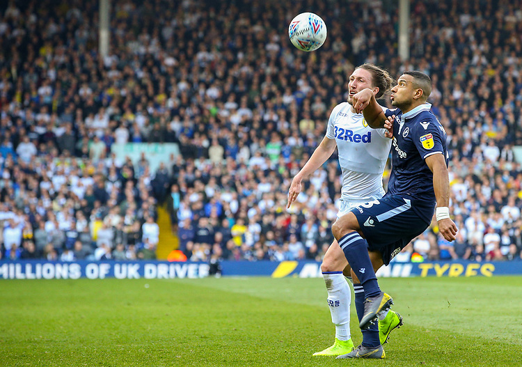 Leeds United's Luke Ayling battles with Millwall's James Meredith<br /> <br /> Photographer Alex Dodd/CameraSport<br /> <br /> The EFL Sky Bet Championship - Leeds United v Millwall - Saturday 30th March 2019 - Elland Road - Leeds<br /> <br /> World Copyright © 2019 CameraSport. All rights reserved. 43 Linden Ave. Countesthorpe. Leicester. England. LE8 5PG - Tel: +44 (0) 116 277 4147 - admin@camerasport.com - www.camerasport.com