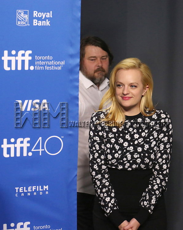 Ben Wheatley and Elisabeth Moss attend the 'High-Rise' photo call during the 2015 Toronto International Film Festival at Roy Thomson Hall on September 14, 2015 in Toronto, Canada.