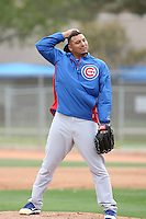 Carlos Zambrano #38 of the Chicago Cubs participates in pitchers fielding practice during spring training workouts at the Cubs complex on February 19, 2011  in Mesa, Arizona. .Photo by Bill Mitchell / Four Seam Images.