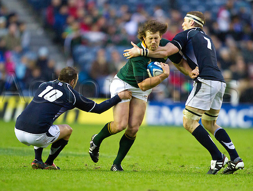 20.11.2010 International Rugby Union from Murrayfield Scotland v South Africa..Scotlands 7 John Barclayand Scotlands 10 Dan Parks combine to stop a South African break