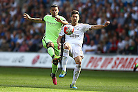 Sergio Aguero of Manchester City and Federico Fernandez of Swansea City in action during the Barclays Premier League match between Swansea City and Manchester City played at The Liberty Stadium, Swansea on 15th May 2016