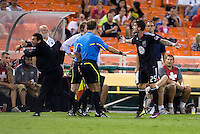 Santino Quaranta, referee, Ben Olsen. D.C. United tied Toronto FC, 3-3, during the game at RFK Stadium in Washington, DC.